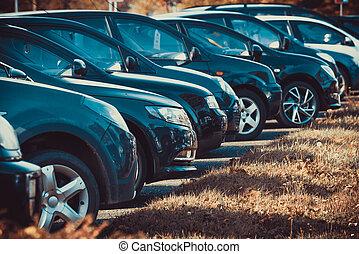 cars row parked at a car dealership stock