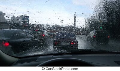 Cars stand at a traffic light, view from driver place, rain...