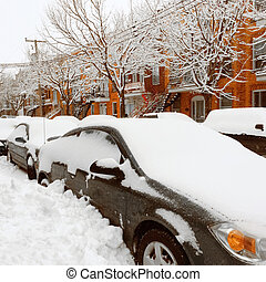 Cars stuck in snow after the snowstorm. Winter in Montreal,...