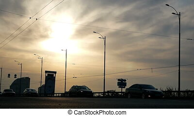 Cars sunset road traffic - Cars motion traveling on road in...