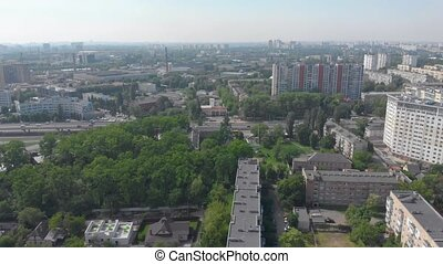 Cars traffic city park aerial residential buildings multi storey drone view movement sunny day Kyiv Ukraine