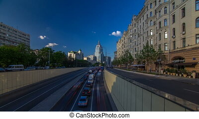 Cars traffic on Garden-Triumph street timelapse hyperlapse in Moscow, Russia. Blue cloudy sky at summer day. Circular avenue goes around central Moscow along old rampart surrounded Zemlyanoy Gorod in 17th century