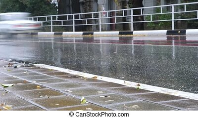 Cars traffic rain, city vehicles drive by, wet tarmac weather. 4k, time lapse