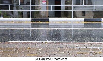 Cars traffic rain, city vehicles drive by, wet tarmac...