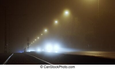 Cars traveling in the fog at night