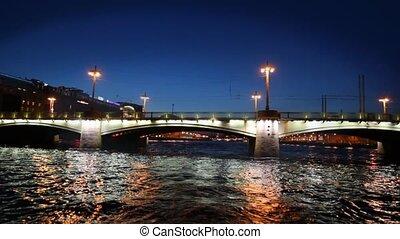 Cars traveling on bridge at night - cars traveling on bridge...