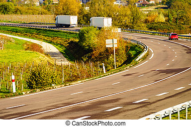 Cars trucks on road in France - Cars semitrailer trucks on ...