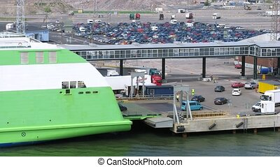 Cars unload from big ferry ship, time lapse - Cars unload...