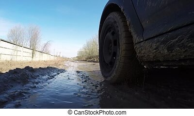 Car's wheels in mud in the forest, off-road. Driving at...