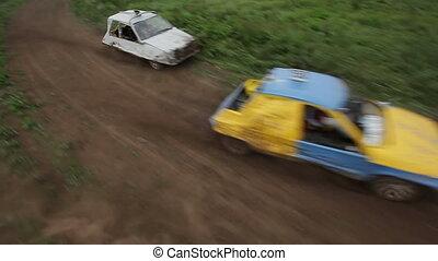 cars wrestling for survival on track, aerial shot