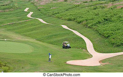 A golf cart path on a course descening into the distance