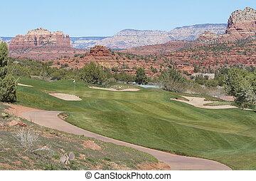 a cart path leads to a scenic sedona arizona golf hole