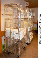 cart with linens for bed in hospital