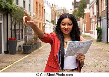 carte, femme, jeune, pointage, tenue