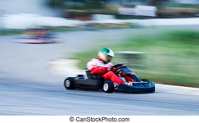Carting - Artistically motion blurred image of a cart race....