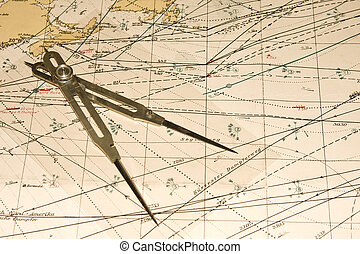 A compass and map showing shipping routes