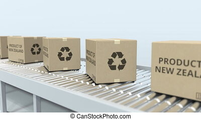 Cartons with PRODUCT OF NEW ZEALAND text on roller conveyor....