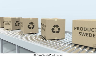 Cartons with PRODUCT OF SWEDEN text on roller conveyor....