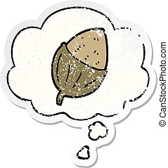 cartoon acorn and thought bubble as a distressed worn sticker