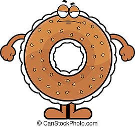 Cartoon Bagel Grumpy - Cartoon illustration of a cream...