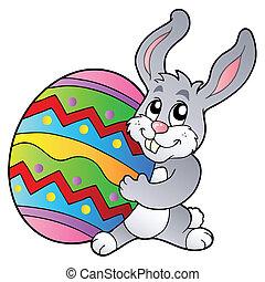 Cartoon bunny holding Easter egg