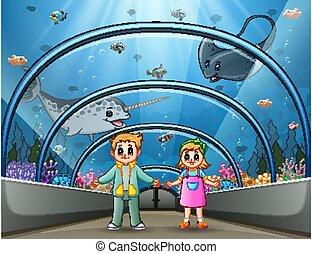 Cartoon children at the aquarium park
