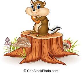 Cartoon chipmunk holding peanut - Vector illustration of...