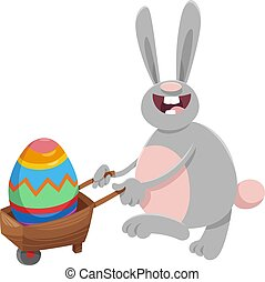 cartoon Easter bunny with big egg on wheelbarrow - Cartoon...