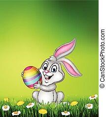 Cartoon little bunny holding Easter egg