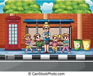 Cartoon of school children in the bus stop with a teacher