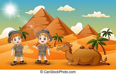 Cartoon of two kids herding a camel in the desert