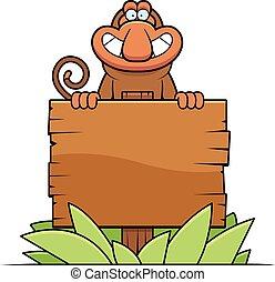 A cartoon illustration of a proboscis monkey with a wooden sign.