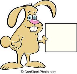 Cartoon rabbit holding a sign.