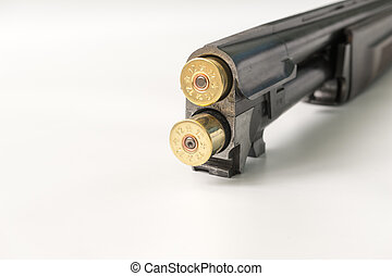 cartridges 12 gauge lying on a light background in close up view side