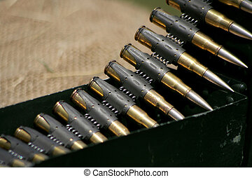 Cartridges for a handgun laying on the cloth