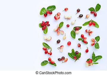 Carunda or Karonda fruits with leaves isolated on white background. Copy space