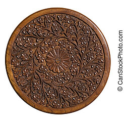 Carved circular wood panel with floral design