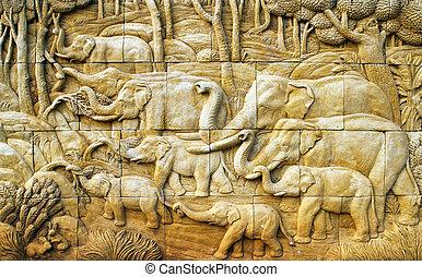 carved Elephant on stone wall