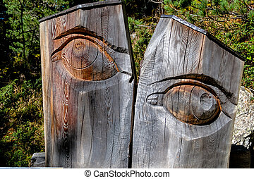 carved eye tree trunk