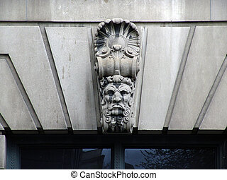 Carved Face  of man on building