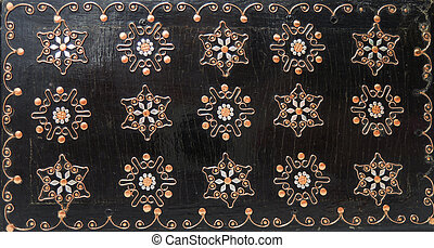 Carved flowers on wooden background
