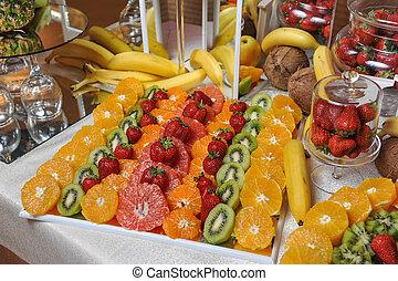 Carved fruits arrangement. Fresh various fruits. Assortment...
