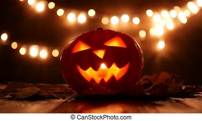 Carved Halloween pumpkin with lights on background. Dark key footage in Ultra Hd resolution. 4k video footage with