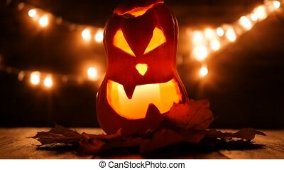 Carved Halloween pumpkin with lights on background. Dark key footage in UltraHd resolution.