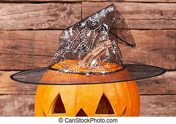 Carved Halloween pumpkin with wizards hat.