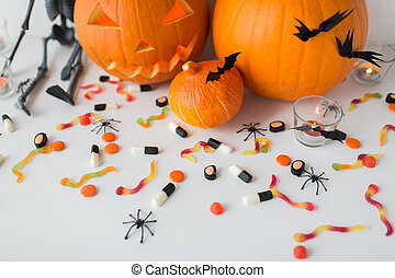 carved halloween pumpkins and candies