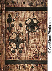 Carved key hole in an antique wooden door.