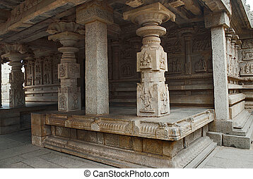 Carved pillars and the carvings on the outer wall of the ...
