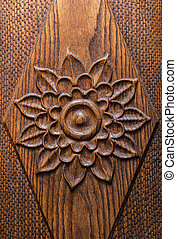 Carved rose detail on a wood