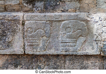 Carved skulls at the Platform of Sculls at the archeological...